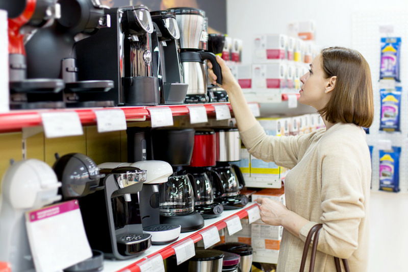 Woman Shopping For A New Coffee Maker