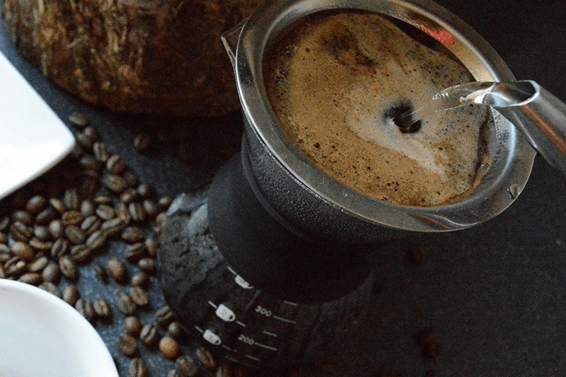 Making Coffee In A Premium Pour Over Drip Coffee Maker