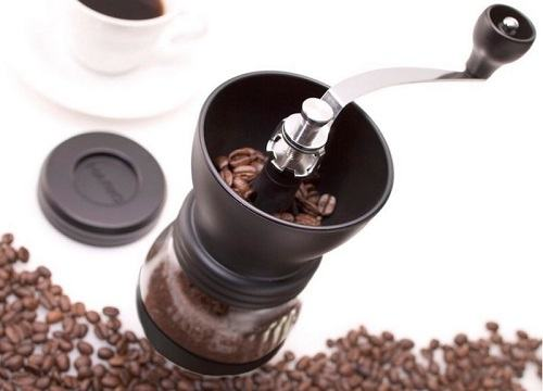 Basic Burr Grinder with Coffee Beans Next to it