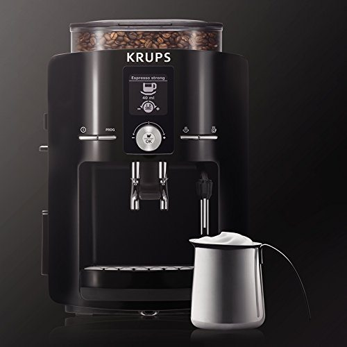 Krups EA8250 Espresseria Fully Automatic Espresso Machine Coffee Maker with Cream Next to it