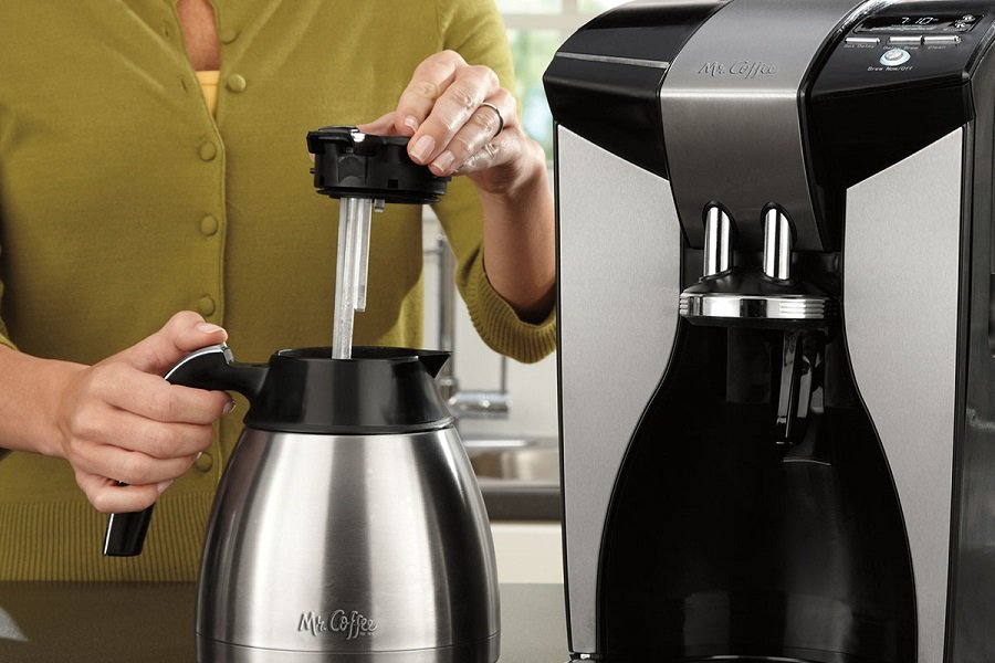 Woman Making Coffee in a Mr. Coffee Optimal Brew 10-Cup Thermal Coffeemaker System, PSTX91