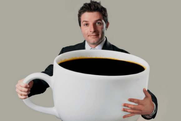 Man Holding Over Sized Coffee Cup