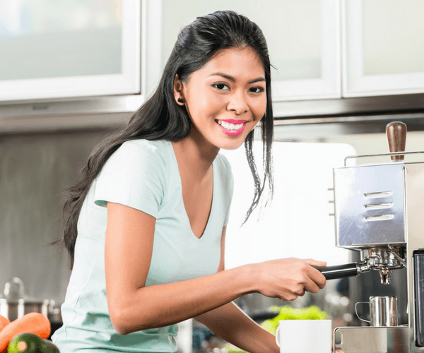 Girl Using Home Espresso Machine