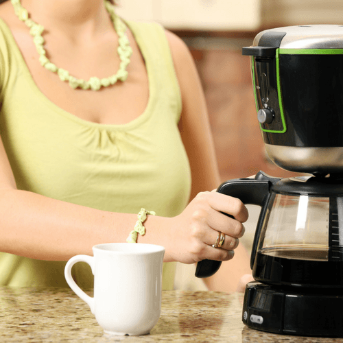 Lady Using A Home Drip Coffee Maker
