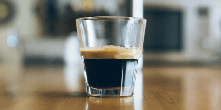 A Glass On Counter With The Perfect Espresso Coffee