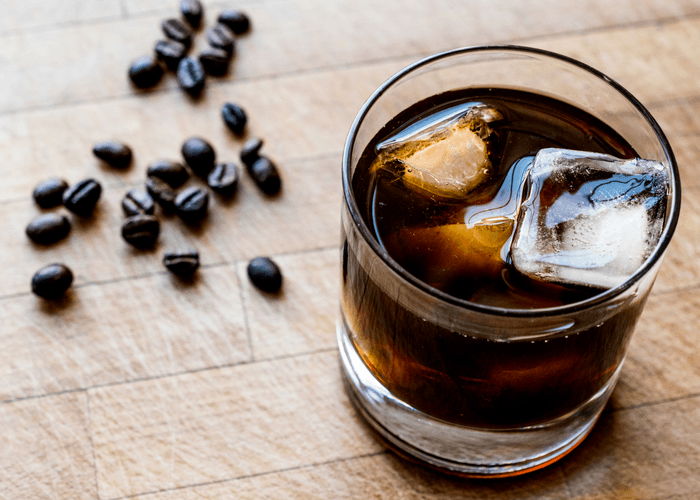 Espresso Tonic On Counter With Coffee Beans