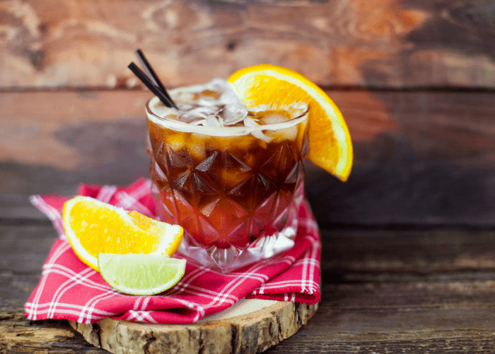 Espresso Tonic With Oranges On Wooden Background