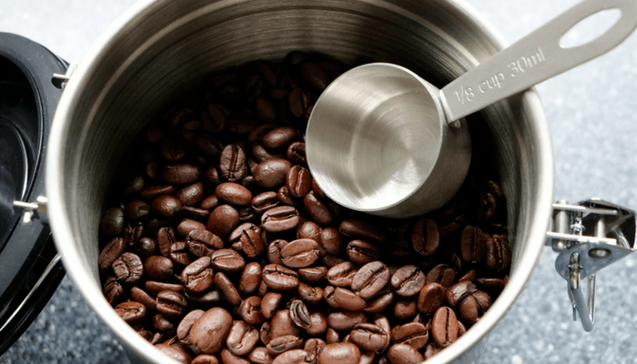 Coffee Beans In Container With Scoop