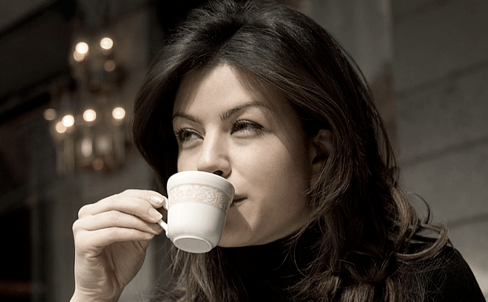 Woman Drinking a Cup of Espresso