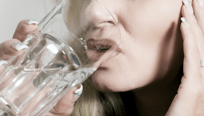 Girl Drinking A Glass Of Water