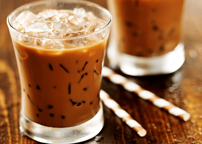 Two Glasses Of Iced Coffee On Wooden Table With Two Straws