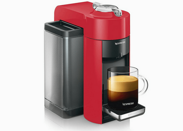 Nespresso Vertuo Evoluo Machine With Cup Of Coffee