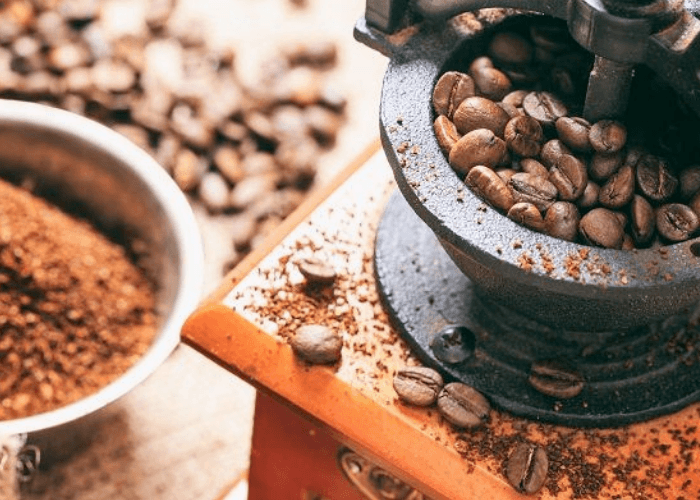 Coffee Grinder With Beans And Ground Coffee