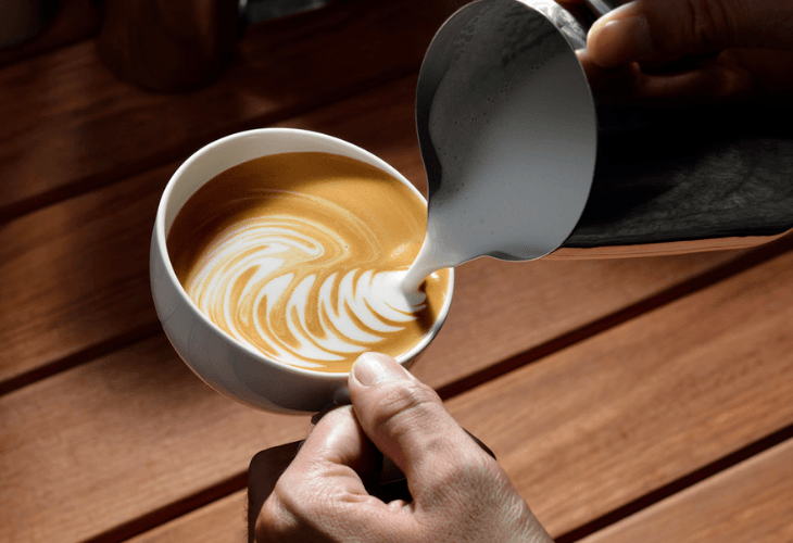 Pouring Froth For Cappuccino Into Cup