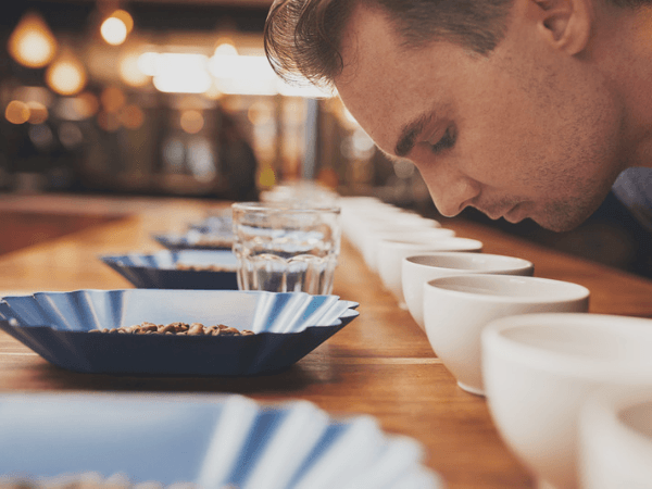 Man Smelling Aromatic Coffee At Tasting