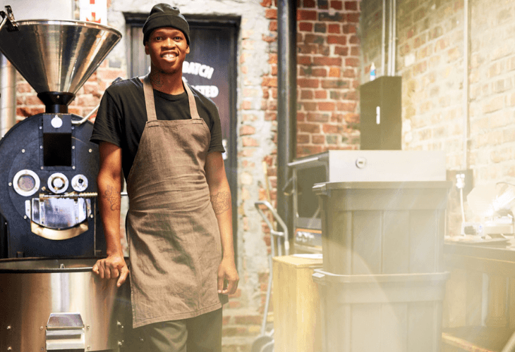 Employee Smiling at the camera in a coffee roasting shop