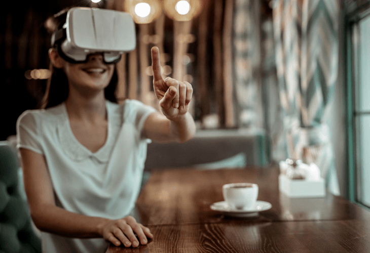 Brunette woman with virtual reality goggles