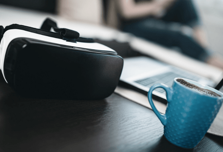 Virtual reality glasses and a cup of coffee