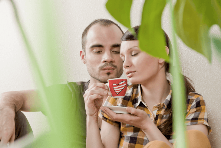 Young loving couple using coffee as an aphrodisiac