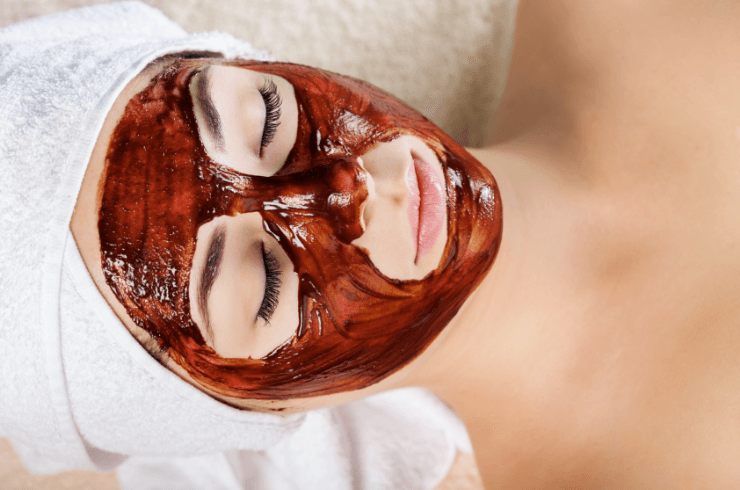 Woman with a honey and coffee mask on her face