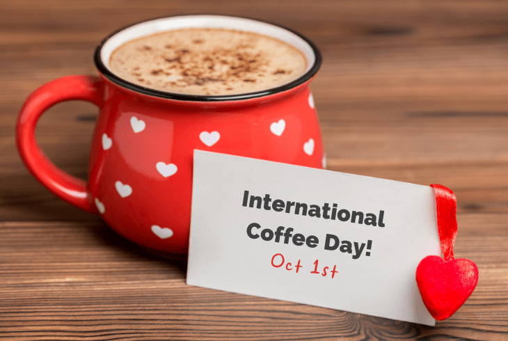 International coffee day sign with a red cup