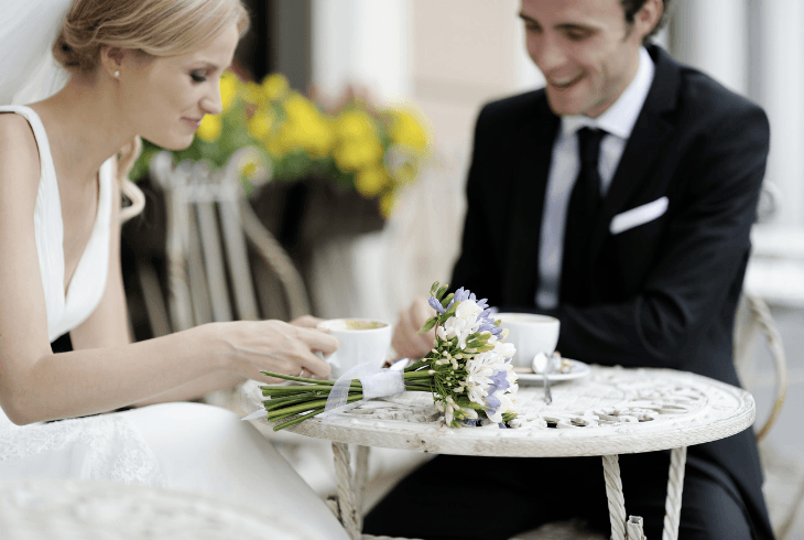 Bride and Groom drinking espresso at their wedding