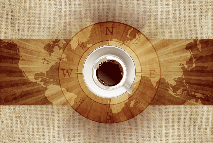 Coffee cup on world map