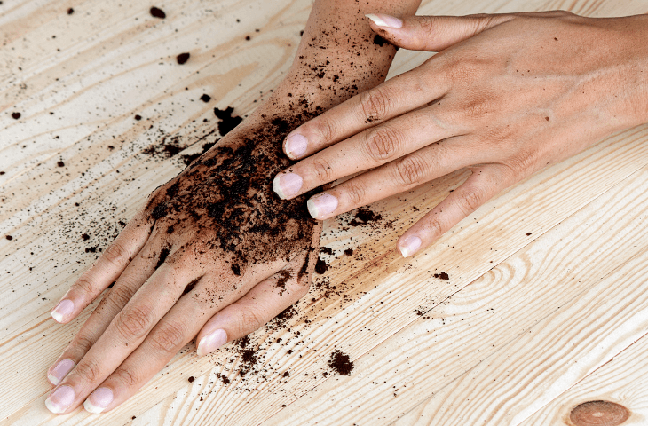 Set of hands applying coffee scrub for anti-aging