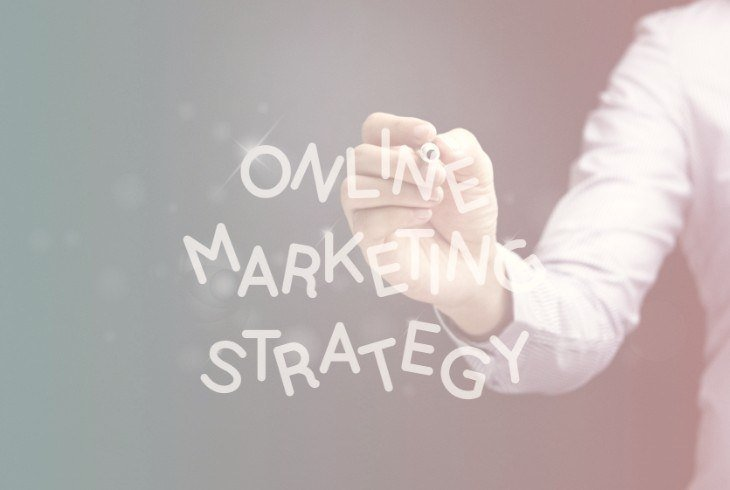 A hand writing online marketing strategy