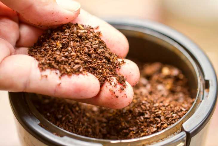 Coarse ground coffee in coffee grinder