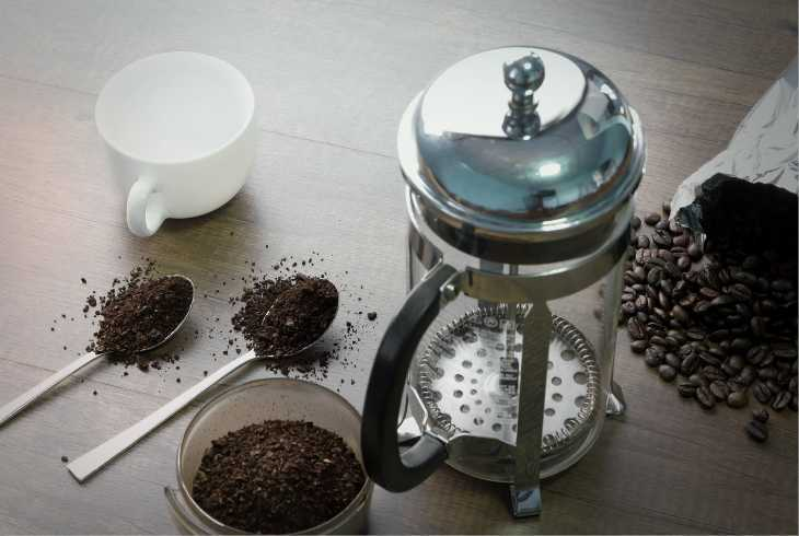 French press with medium roasted coffee and beans