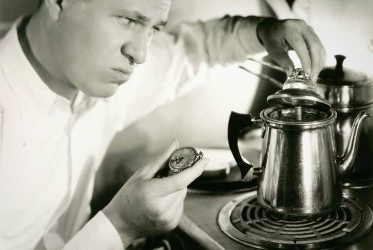 Man making coffee in a stovetop percolator