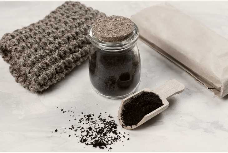Used coffee grounds with sponge for cleaning in the kitchen
