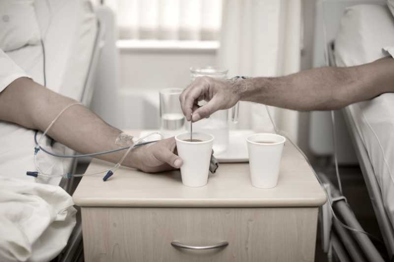 Two patients drinking coffee after surgery