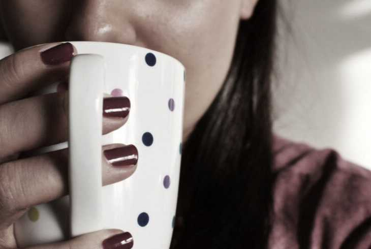Young woman sipping her morning joe