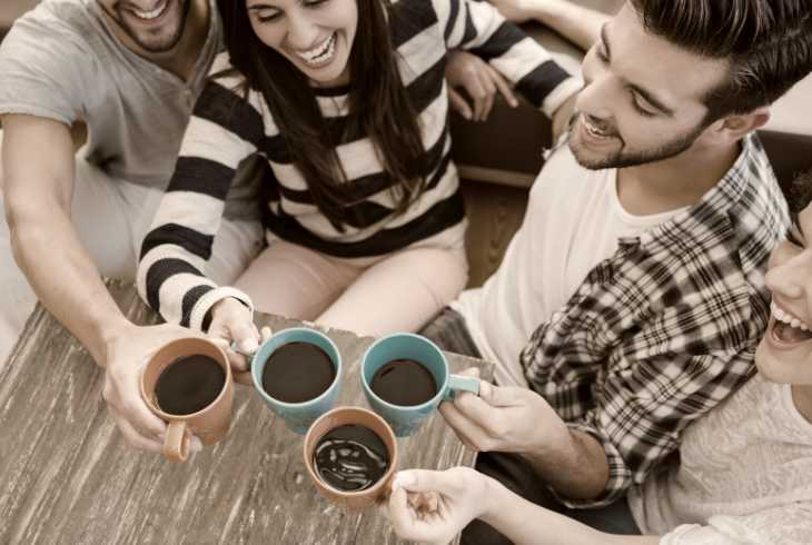 Four friends socializing with coffee
