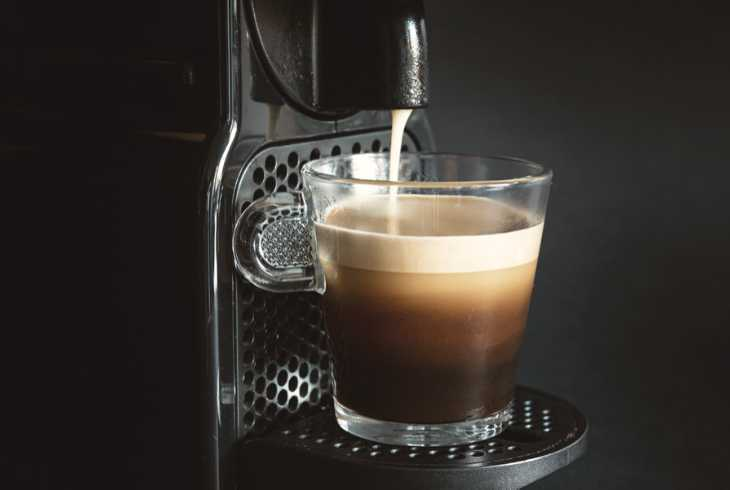 Nespresso machine brewing a cup of coffee