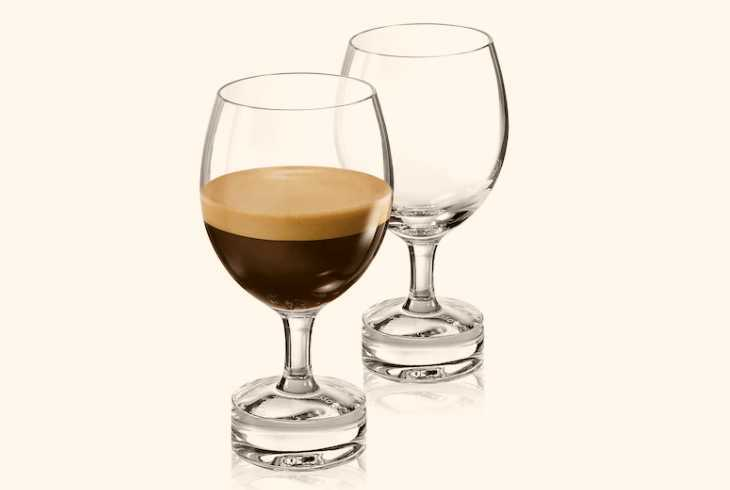 Two espresso glasses on white background