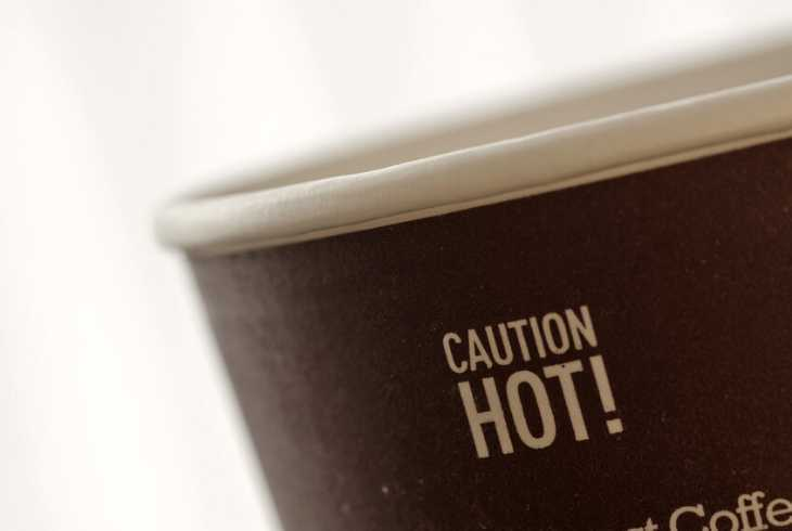 Caution sign on hot coffee