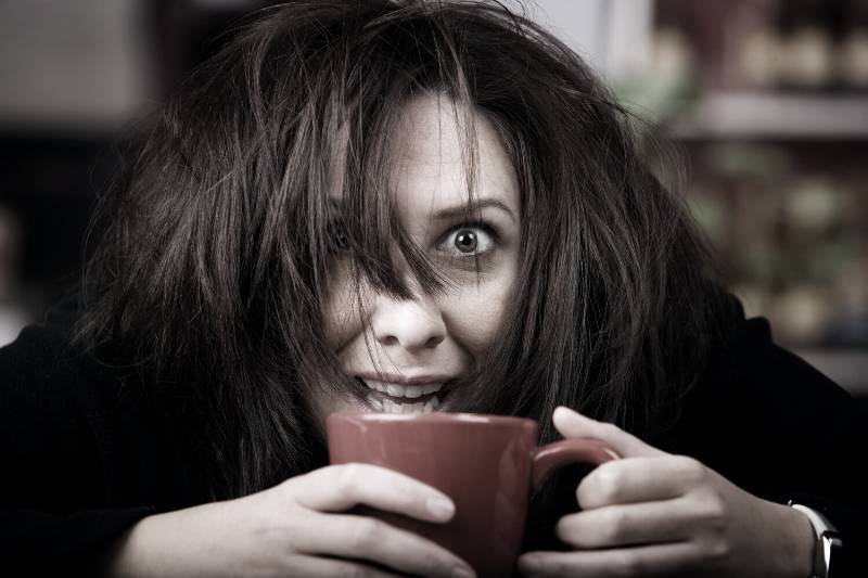 Woman suffering the negative effects of caffeine